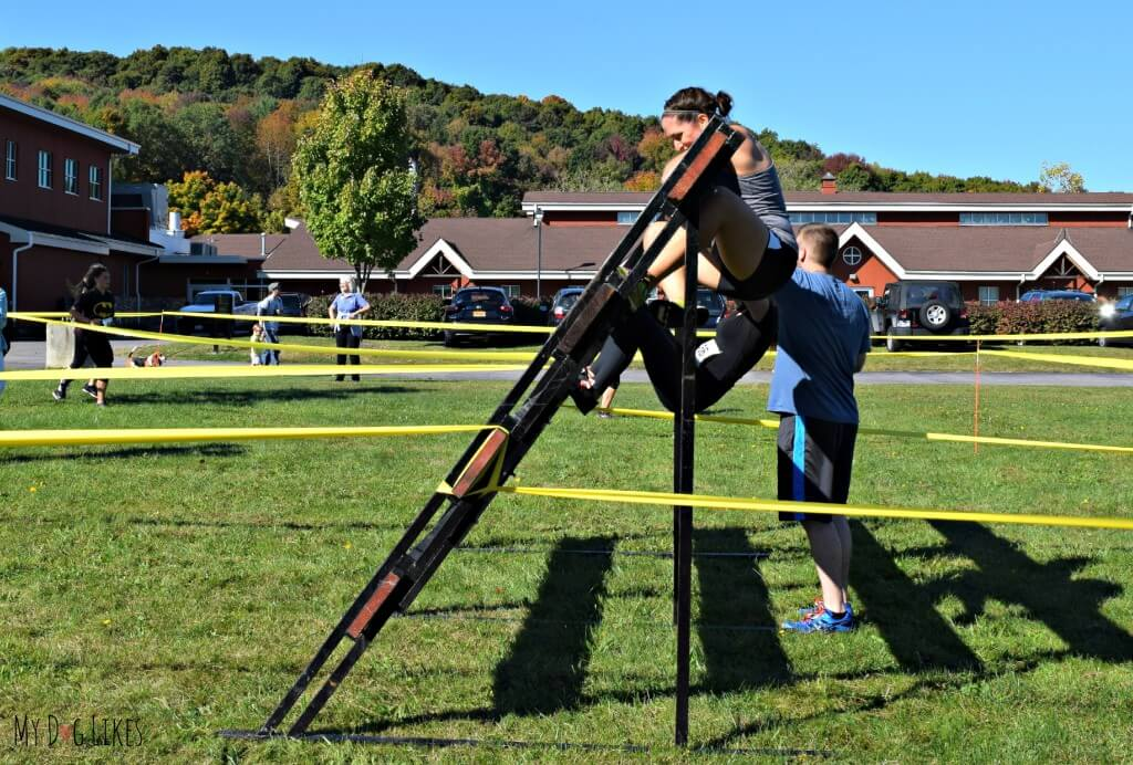 Rachael climbing an inverted obstacle at Lollypop Farm's Ruff Rampage 5K