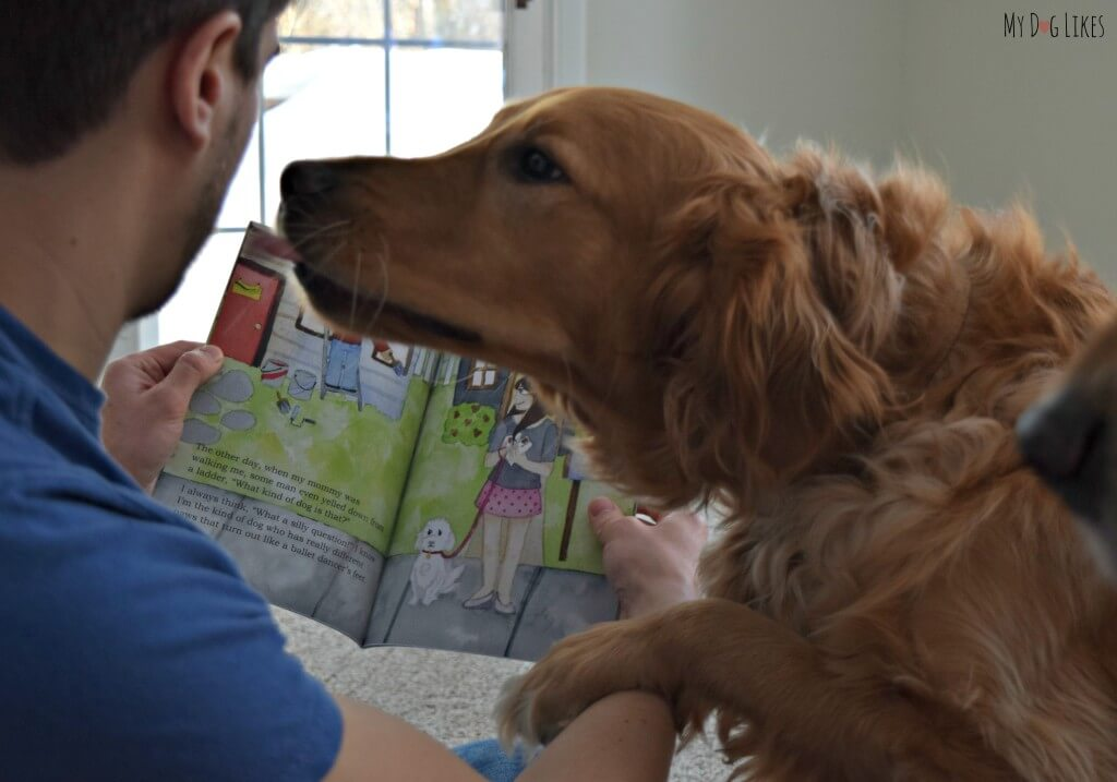 "Receiving some dog kisses while reading Charlie ""What Kind of Dog Am I?"""