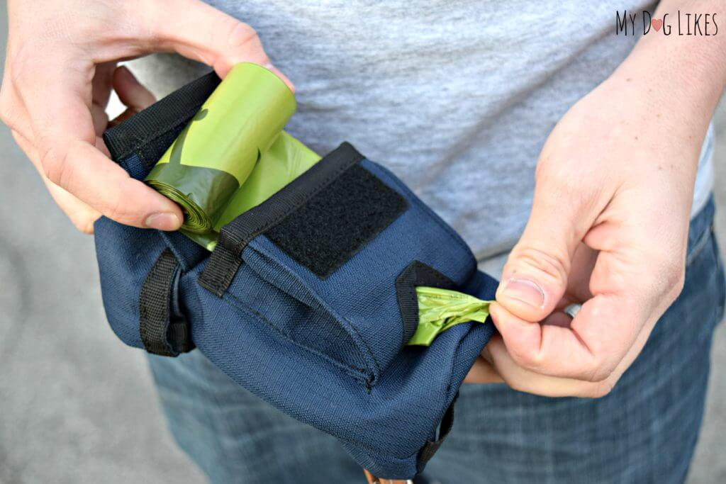 Built in poop bag dispenser - comes loaded with Earth rated poop bags!