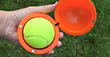 The Fetch It is designed to hold a tennis ball - so that you don't have to!