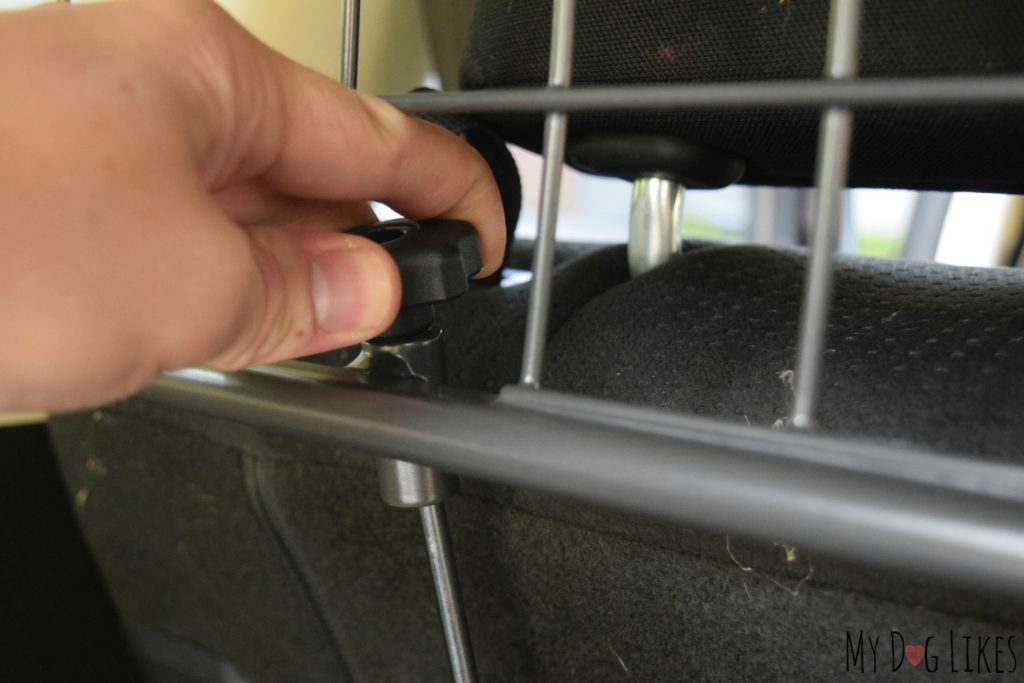 Tightening the vertical adjustment knob for a secure fit
